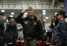 U.S. Navy Admiral Harry Harris, Commander of the U.S. Pacific Command, salutes at a ceremony marking the start of Talisman Saber 2017, a biennial joint military exercise between the United States and Australia, aboard USS Bonhomme Richard on June 29, 2017. President Donald Trump has announced the intention to nominate Harris to be the next U.S. ambassador to Australia. (Jason Reed/AFP/Getty Images)