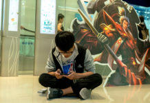 A young player practices outside a shopping mall, where a battle match of mobile game Honor of Kings is held in Tianjin, China on Oct. 1, 2017. (Zhang Peng/LightRocket via Getty Images