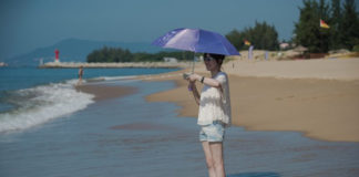 In this picture taken on October 12, 2016, a tourist enjoys the beach at the Club Med resort in Sanya, Hainan Province in China. (Nicolas Asfouri/AFP/Getty Images)