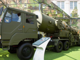"""A transporter erector vehicle used to launch the Intermediate-Range Ballistic Missile DF-21A on display at the """"Our troops towards the sky"""" exhibition at the Beijing Military Museum in August 2007. A version of the DF-21 missile is designed to take out U.S. carriers operating in the western Pacific. (Max Smith via Wikimedia Commons)"""