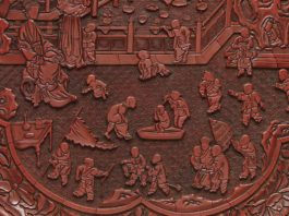 Tray with Women and Boys on a Garden Terrace, 14th century, Yuan Dynasty (1271-1368), carved red lacquer. (Image:The Met/ Wikicommons)