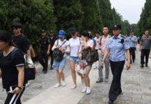 Hundreds of police swarmed the streets of Beijing's financial district on August 6 as Chinese authorities aggressively quashed a planned protest against losses sustained by peer-to-peer (P2P) lending platforms. (GREG BAKER/AFP/Getty Images)
