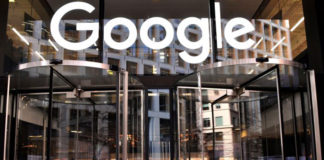 A logo is pictured above the entrance to the offices of Google in London on Jan. 18, 2019. (Ben Stansall/AFP/Getty Images)