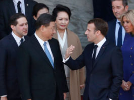 French President Emmanuel Macron and his wife Brigitte Macron (R) speak with Chinese leader Xi Jinping and his wife Peng Liyuan (C) following a meeting at the Elysee Palace in Paris on March 26, 2019. (THIBAULT CAMUS/AFP via Getty Images)