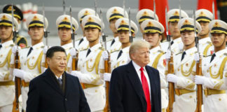 President Donald Trump takes part in a welcoming ceremony with Chinese leader Xi Jinping in Beijing on Nov. 9, 2017. (Thomas Peter-Pool/Getty Images)