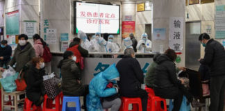 Patients wait for treatment at Wuhan Red Cross Hospital in Wuhan, China on January 24, 2020. (HECTOR RETAMAL/AFP via Getty Images)