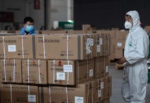 Staff members and volunteers transfer medical supplies at a warehouse of an exhibition center which has been converted into a makeshift hospital in Wuhan, China, on Feb. 4, 2020. (STR/AFP via Getty Images)