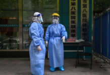 Medical workers are seen as they take swab samples from people to be tested for the COVID-19 novel coronavirus in Wuhan, China's central Hubei province on April 16, 2020. (Hector Retamal/AFP via Getty Images)